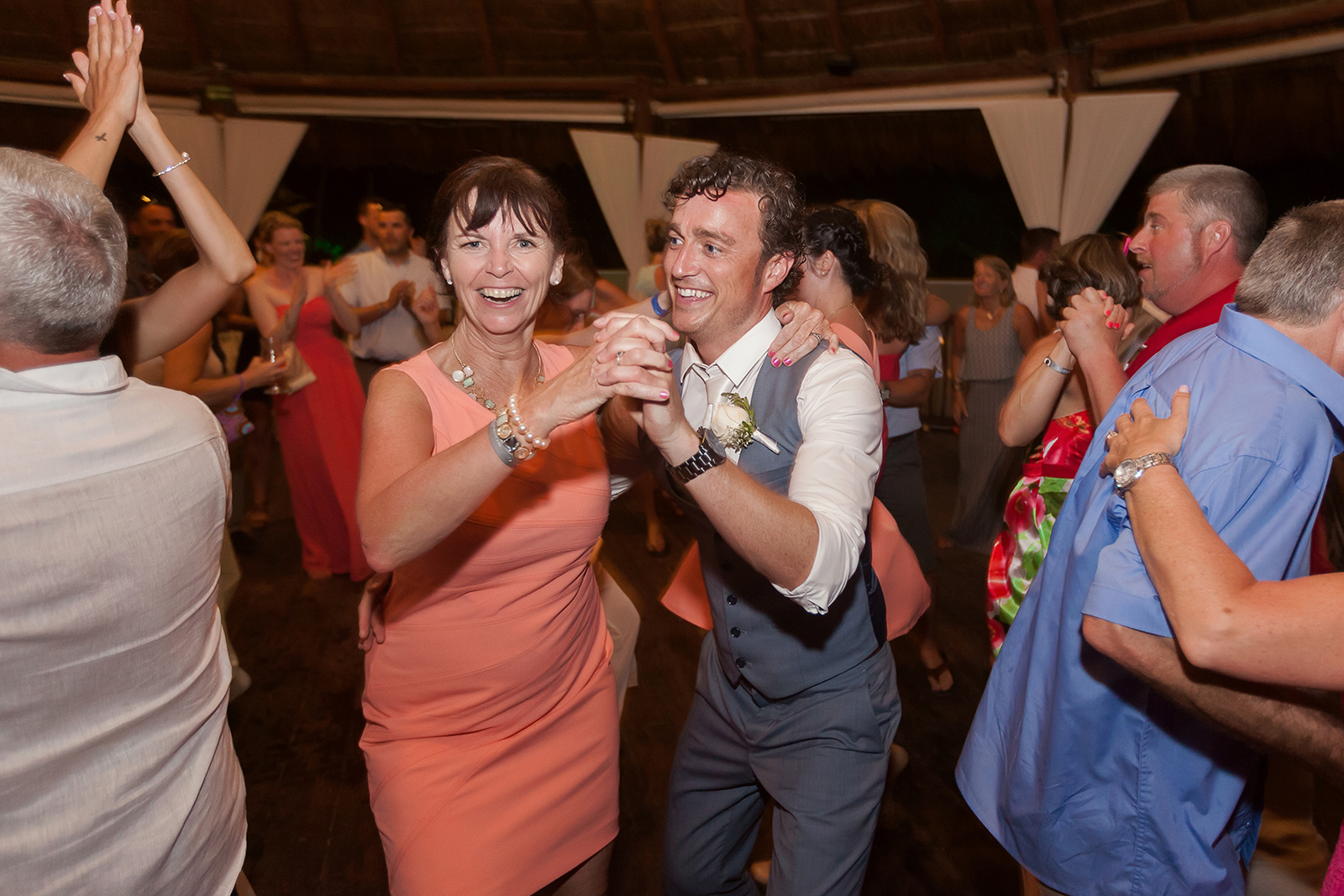 Groom dancing at wedding reception photography Grand Sirenis