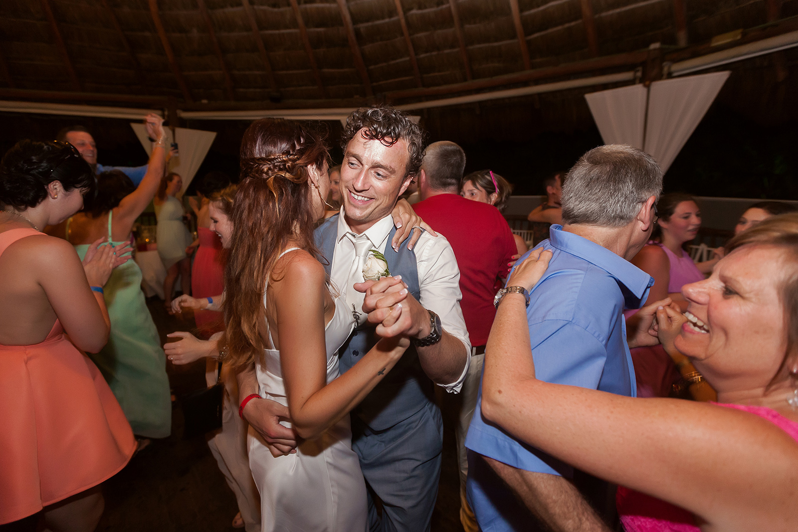 Couple having fun at Grand Sirenis Wedding Reception