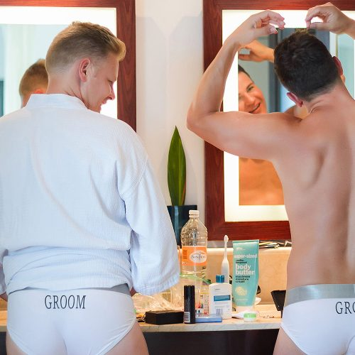 Grooms getting ready for gay wedding at Live Aqua Cancun
