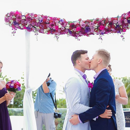 Grooms first kiss at gay wedding ceremony