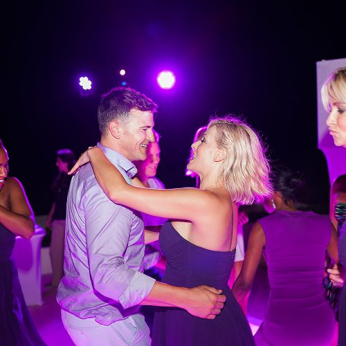 Guest dancing with groom at Live Aqua Cancun wedding reception