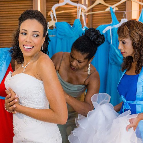 Bride putting on her dress at El Dorado Seaside Suites wedding