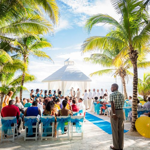 Wedding ceremony with guests at El Dorado Seaside Suites