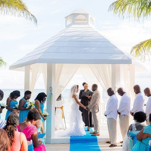Wedding ceremony at beachside gazebo at El Dorado Seaside Suites