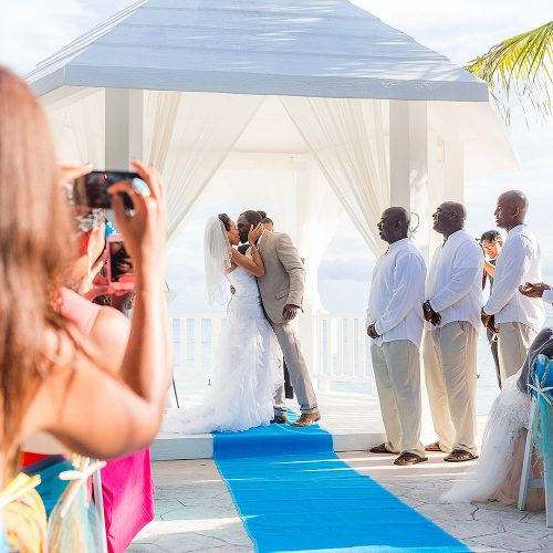 Bride and grooms first kiss at wedding ceremony