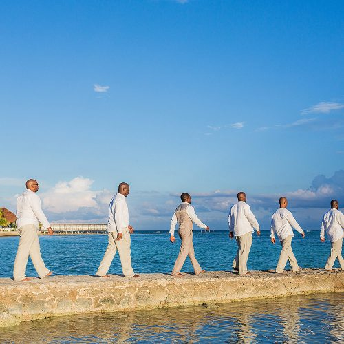 Groomsmen walking Beatles style at El Dorado Seaside Suites