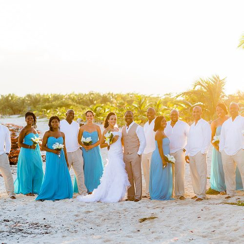 Bridal party on beach at El Dorado Seaside Suites