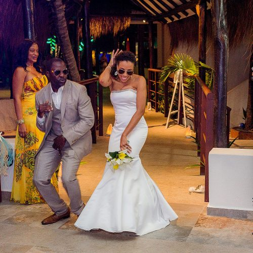 Bride and groom dancing as they enter wedding reception at El Dorado Seaside Suites