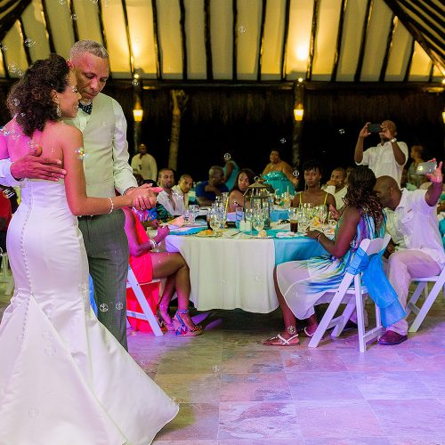 Bride dancing with father at El Dorado Seaside Suites wedding reception