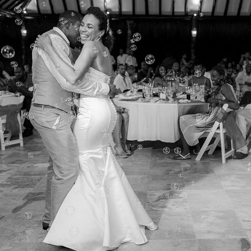 Bride dancing with groom at El Dorado Seaside Suites wedding reception