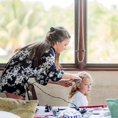 Flower girl having her hair done in Tulum