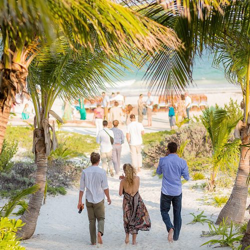 Guests walking to wedding reception in Tulum