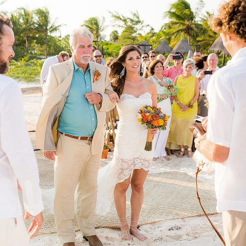 Bride and father after walking down the aisle in Tulum