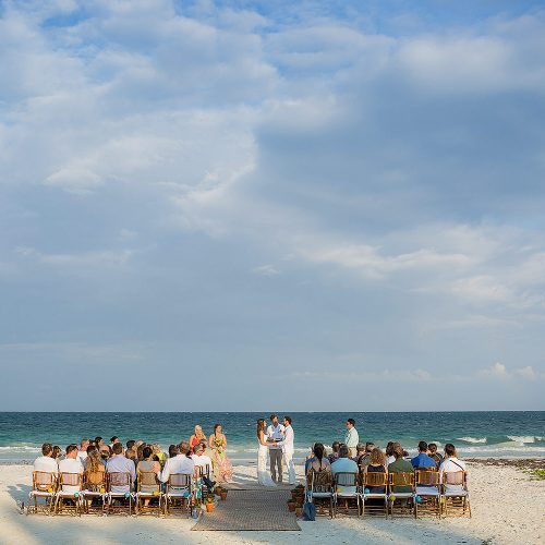 Wedding ceremony with guests at Tulum wedding