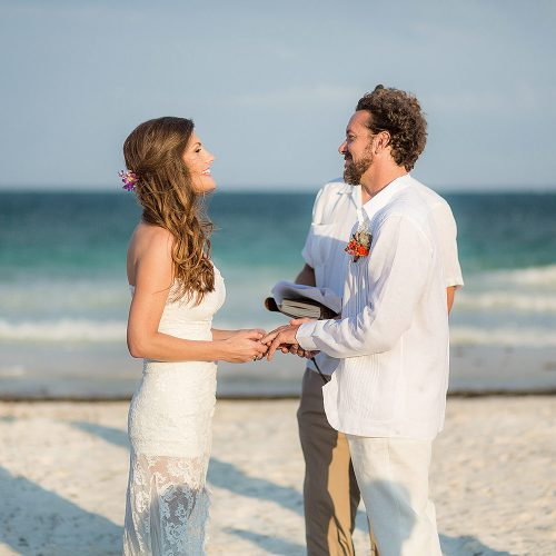 Bride and groom saying vows at Tulum wedding