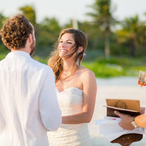Bride and groom during ceremony at Tulum wedding