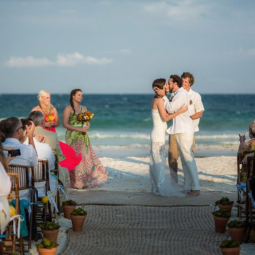 Bride and Grooms first kiss at wedding in Tulum