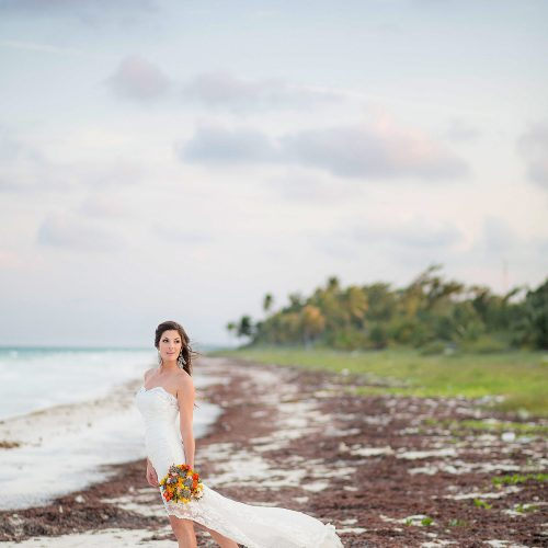 Bride on beach in Tulum wedding