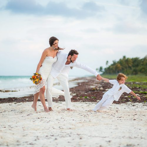 Bride and groom with their son after wedding in Tulum
