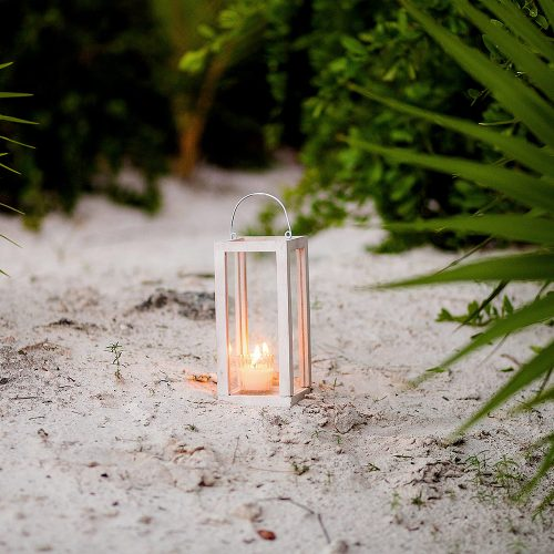 Candles on sand at wedding in Tulum