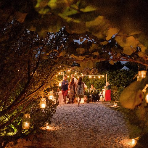Candle lit walk way to wedding reception location in Tulum