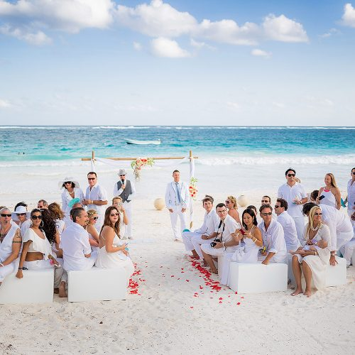 Wedding ceremony on beach with guests at Hacienda Paraiso, Tulum