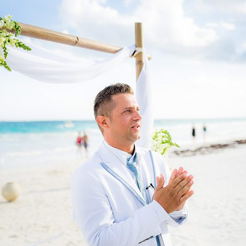 Groom waiting for bride at wedding in Tulum