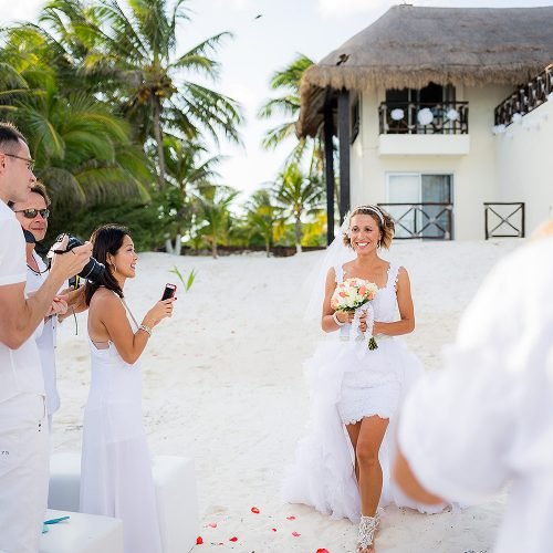 Bride walking down sand aisle are Hacienda Paraiso, Tulm