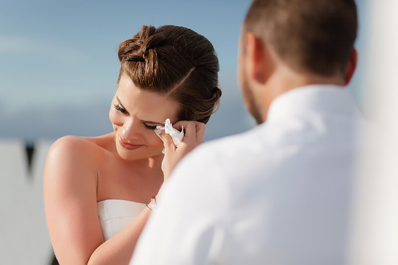 Bride crying during ceremony at Azul Fives wedding