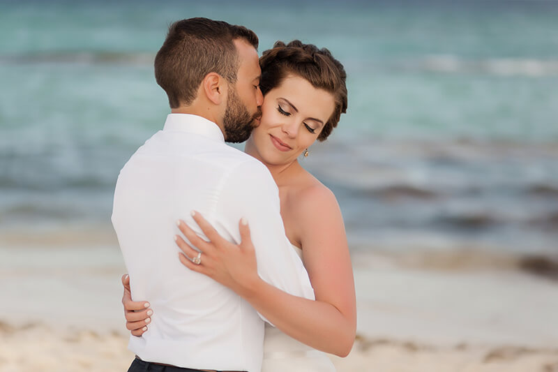 Bride and groom on beach at Azul Fives