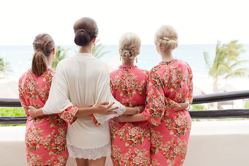 Bridal party looking at the ocean at Secrets Maroma Beach Riviera Cancun Resort