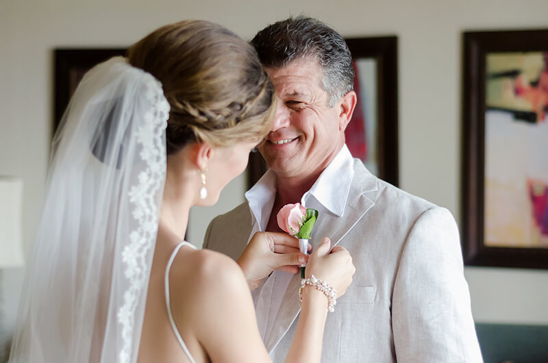 Bride pinning boutonnière to father at Secrets Maroma Beach Riviera Cancun Resort