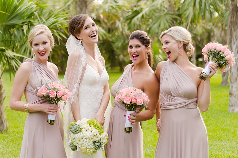 Bridesmaids laughing during photo shoot at Secrets Maroma Beach Riviera Cancun Resort