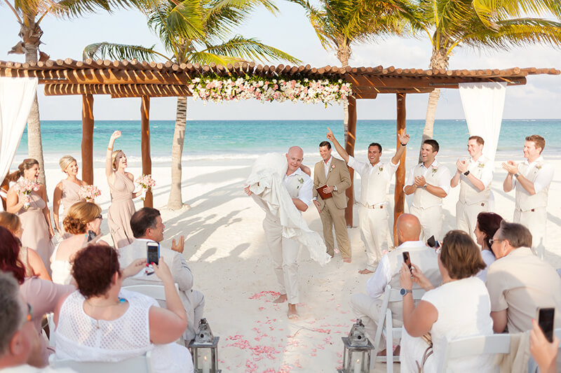 Couple walking from the gazebo at their wedding ceremony at Secrets Maroma Beach Riviera Cancun Resort