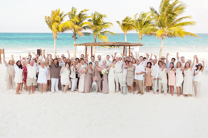 Group photo at Secrets Maroma Beach wedding