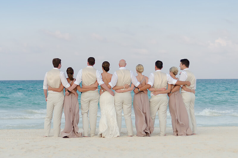 Bridal party overlooking at the ocean at Secrets Maroma Beach Riviera Cancun Resort