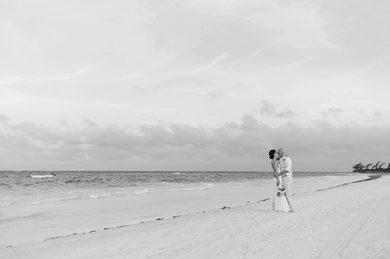 Black and White photo of bride and groom on beach at Secrets Maroma Beach wedding