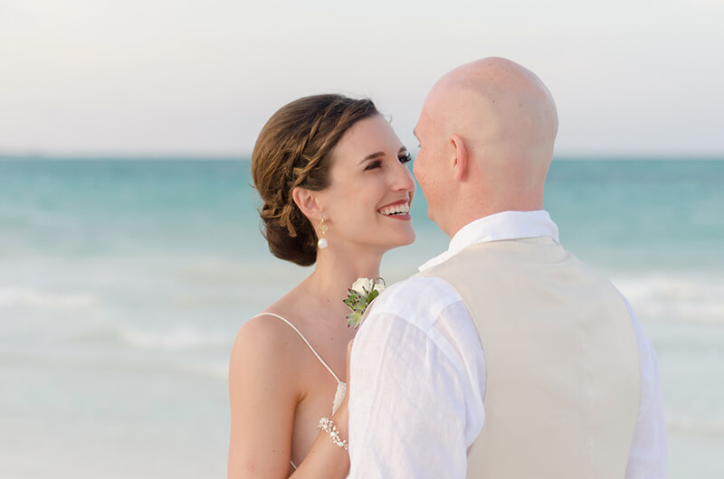 Couple looking at each other at wedding photo shoot at Secrets Maroma Beach Riviera Maya Resort