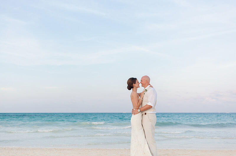 Bride and groom on beach at Secrets Maroma Beach Riviera Cancun Resort