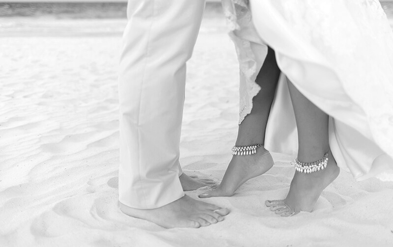 Black and white close up picture at couples feet at Secrets Maroma Beach wedding