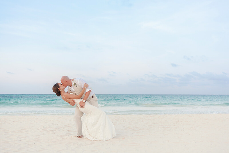 Groom kiss dipping Bride at Secrets Maroma Beach wedding