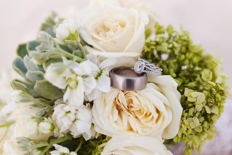 Closeup detail or wedding bouquet and ring picture at Secrets Maroma Beach Riviera Cancun Resort