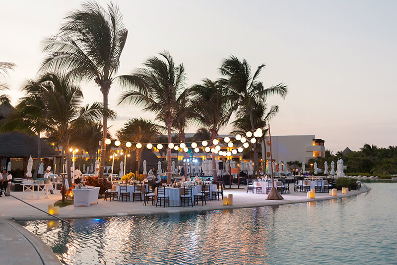 Poolside wedding reception venue at Secrets Maroma Beach Riviera Cancun Resort