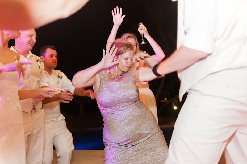 Guests having fun at wedding reception at Secrets Maroma Beach Riviera Cancun Resort