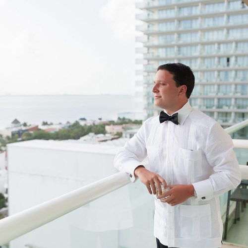 Groom looking at the ocean at Hard Rock Cancun wedding