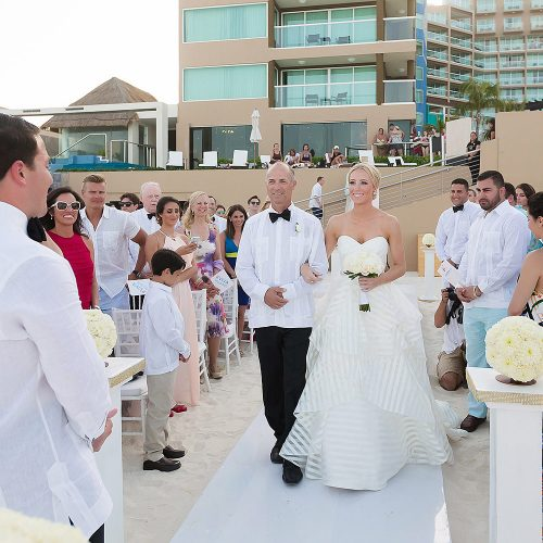 Father of the brie walking her down the aisle at Hard Rock Cancun beach wedding