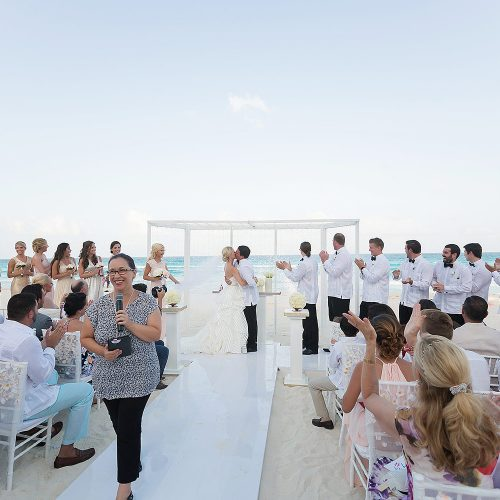 Couple kissing at Hard Rock Cancun beach wedding