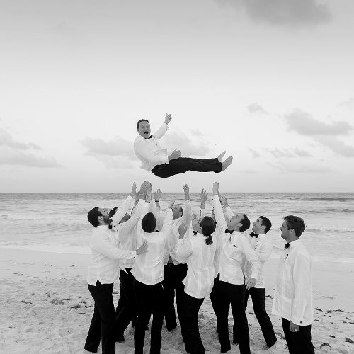 Groom toss at Hard Rock Cancun beach wedding