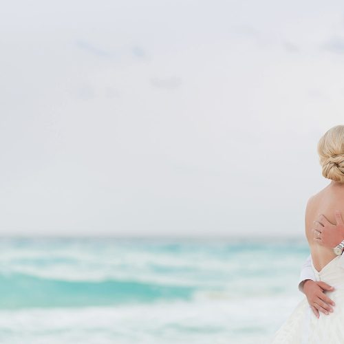 Couple kissing at the beach at Hard Rock Cancun beach wedding