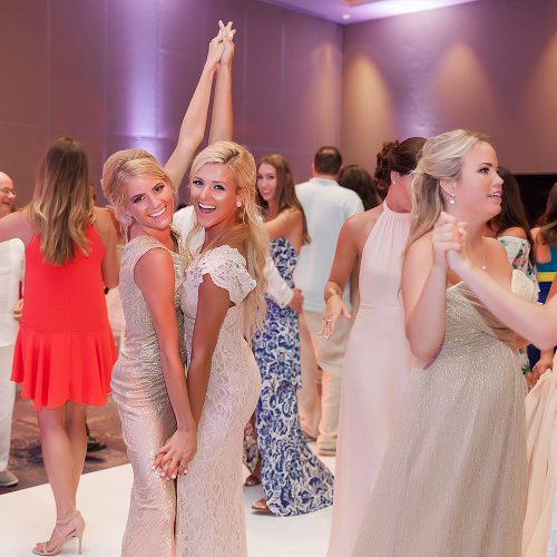 Bridesmaids having fun at Hard Rock Cancun wedding reception